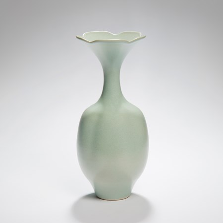 tall melon coloured porcelain vase sculpture with foliate rim