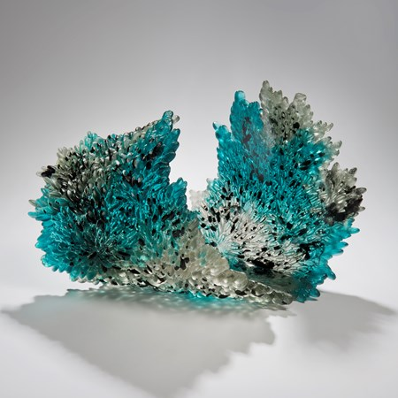 art-glass sculpture of curled leaf in turquoise black and crystal