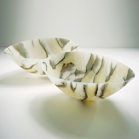 two concave art glass bowls in white with grey and beige pattern