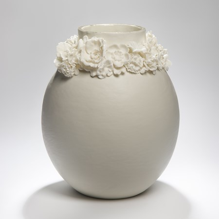 porcelain forget me not vase sculpture with gold lustre trim around the top edge