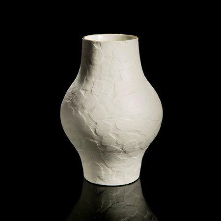 porcelain ceramic sculptured vessel with wider midriff
