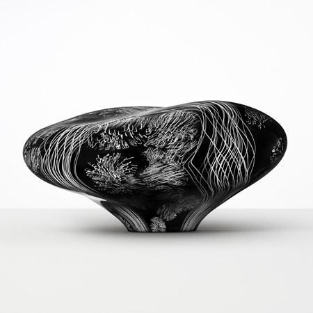 abstract brain-shaped clear glass sculpture in black with white etched patterning throughout