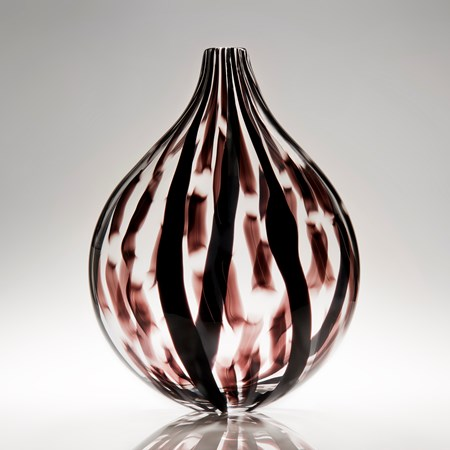 sculpted glass vessel with round base and short neck with black and dark red lined patterns