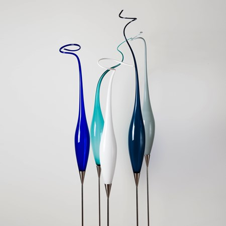 tall thin abstract glass sculptures on steel base in white blue turquoise dark green and grey