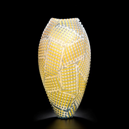 art glass vase with crossing amber stitch pattern