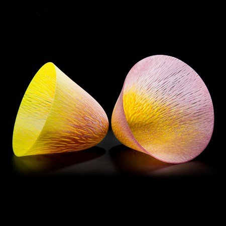 two art glass cone shaped vessels in yellow and pink