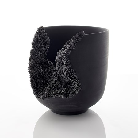 modern porcelain sculpture art of bowl in black with collapsed open side