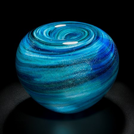 blue and black sculpted glass vessel with ringed swirl pattern