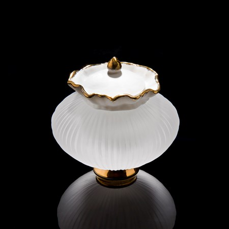 small glass and porcelain artwork of teapot with gold base and trim