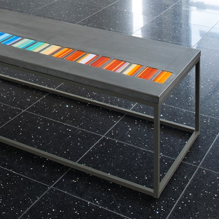 coffee table made from steel and concrete with pastel coloured art glass inlays