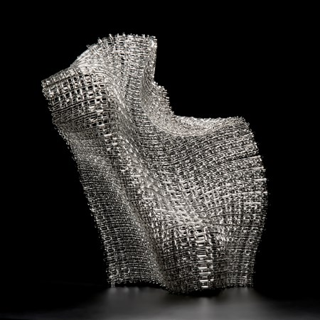 woven art glass sculpture in silver resembling wire mesh structure