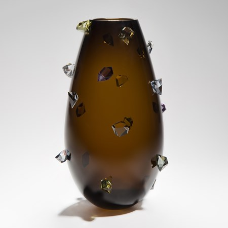Handblown modern art-glass vase in dark red decorated with sparse white crystals on the outside