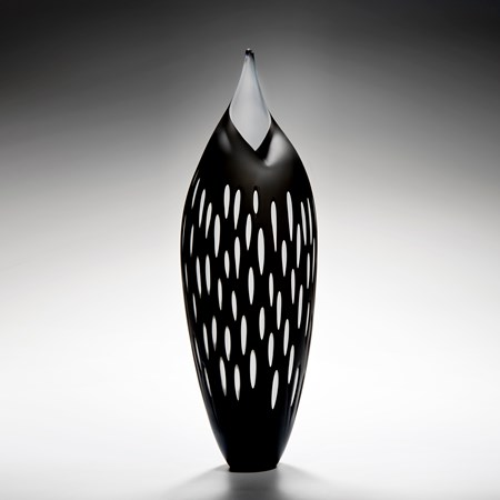 bird like glass artwork in black with white trim