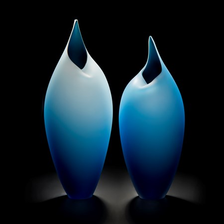 minimal blown glass sculpture of two birds in blue