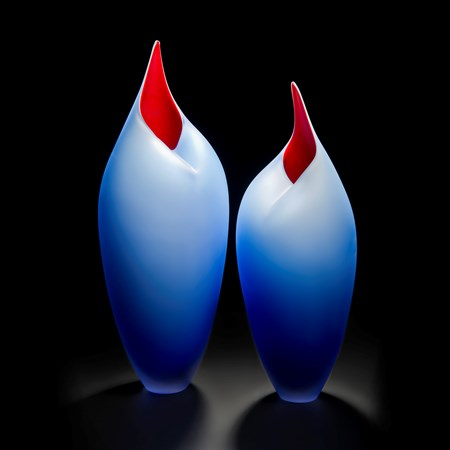 minimalist blown glass sculpture of birds in blue and red