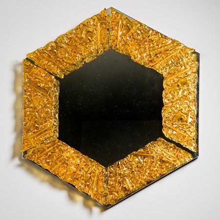hexagonal decorative mirror with crusted amber glass border