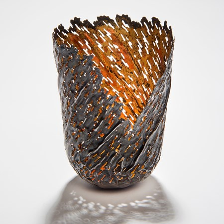 contemporary art sculpture of re-formed steel can with orange gold inlay and open edge