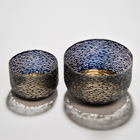 two decorative reformed steel can bowls in blue and grey with gold patterned interior and exterior