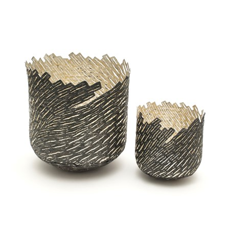 one large one small vessels with wood-like external pattern made from steel and gold