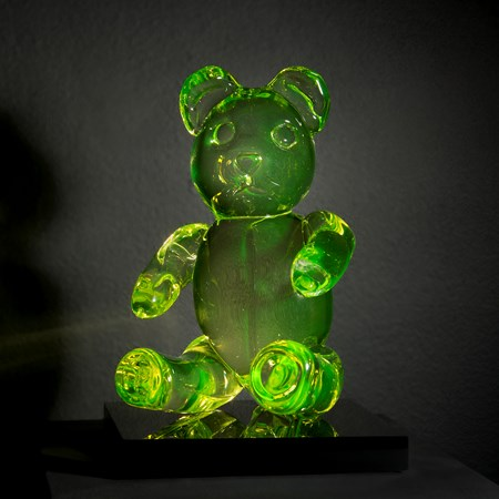 neon green coloured glass art sculpture of teddy bear