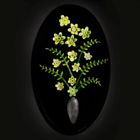 art glass sculpture of flowers in green and yellow on black background