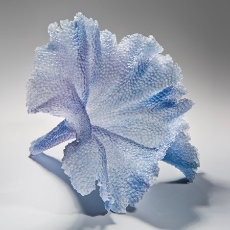 modern art glass sculpture of leaf in light blue