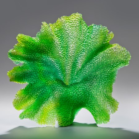 glass art sculpture of leaf in bright green