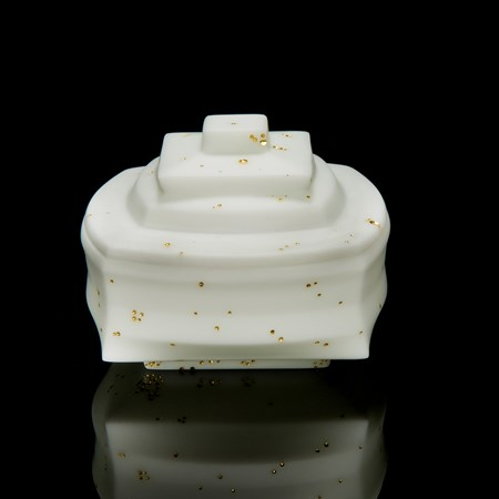 white cast glass sculptural art container with lid with gold speckles