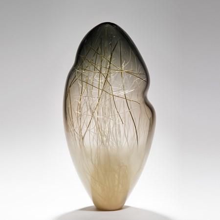 seethrough tall art glass sculpture with internal structure resembling abstract winter scene