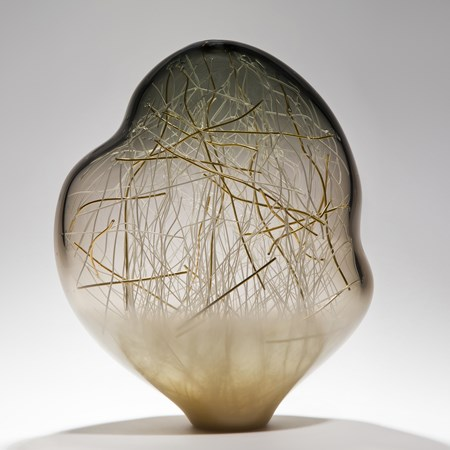 seethrough art glass sculpture with internal structure resembling abstract winter scene