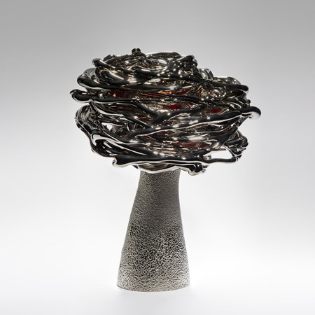 black red and platinum art-glass sculpture from blown glass of flower in wind