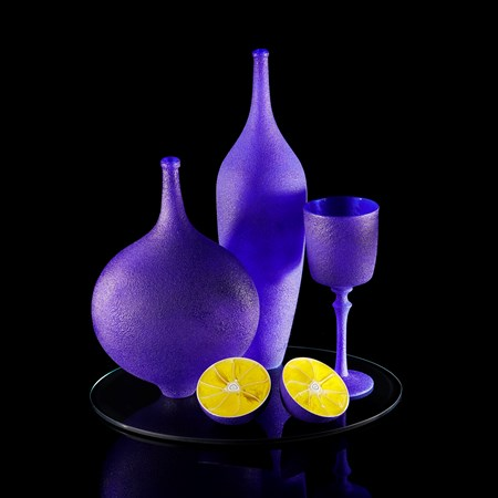 handblown and sculpted glass art still life in blue and yellow of lemons and ornaments