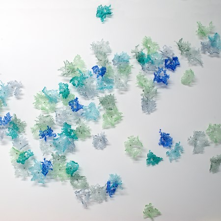 decorative modern art glass wall art in green blue and turquoise