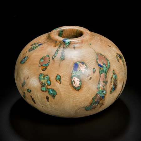 short sculpted vessel from natural looking ash wood and precious minerals in beige brown and speckled turquoise