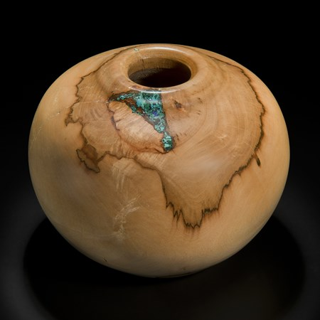 sculpture of vessel made from sycamore in creamy brown inlaid with precious minerals