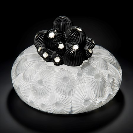 white star coral themed glass artwork with black berries protruding from centre