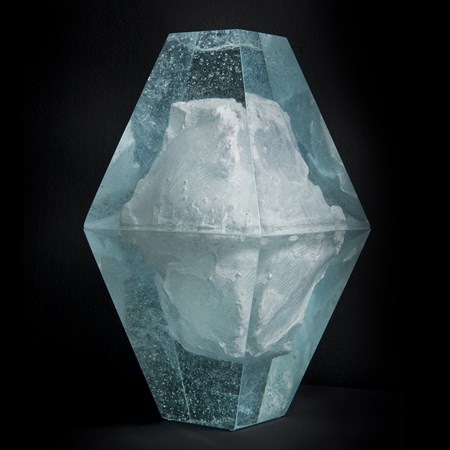 art glass sculpture of ice block frozen inside diamond shaped glass capsule