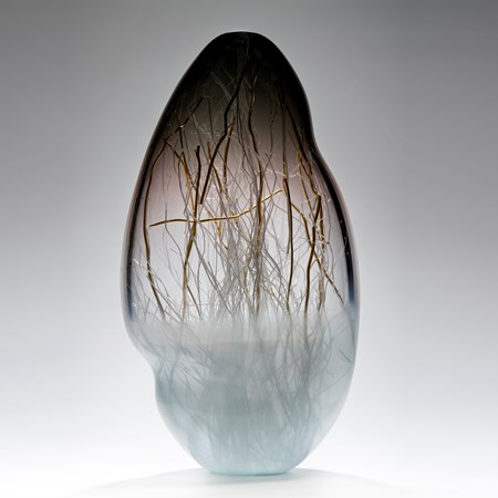 glass art vessel sculpture in grey and light blue with internal gold wire structure
