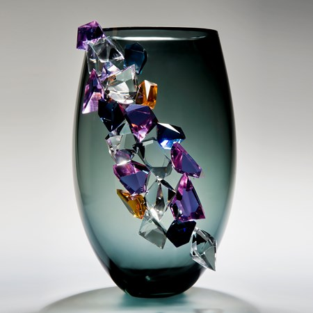 modern grey glass vase sculpture with large coloured crystal exterior