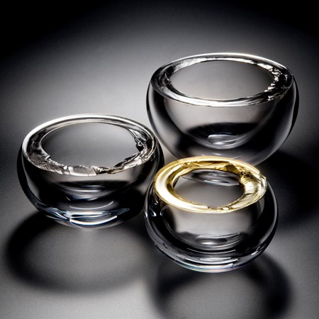 three modern art glass bowls in clear glass with gold or platinum rims