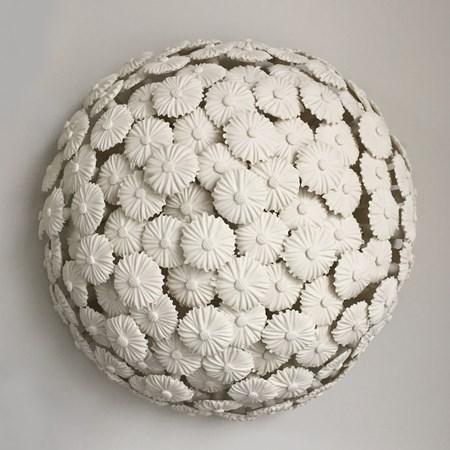 porcelain art sculpture of flowers arranged in sphere