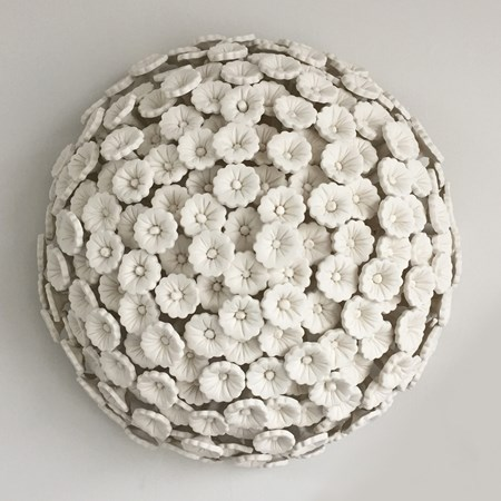 porcelain art sculpture of daisies arranged in sphere