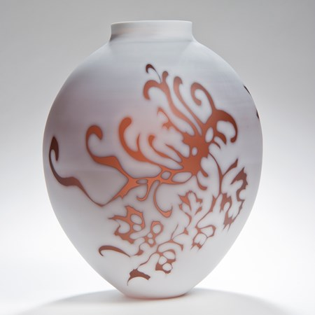short round white cameo glass sculpture with orange floral motif