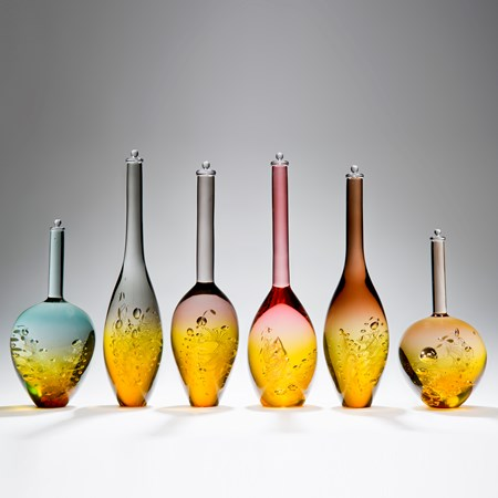 six assorted sculpted art glass bottles in amber and pastel