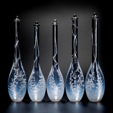 five blue art glass bottle sculptures with long necks