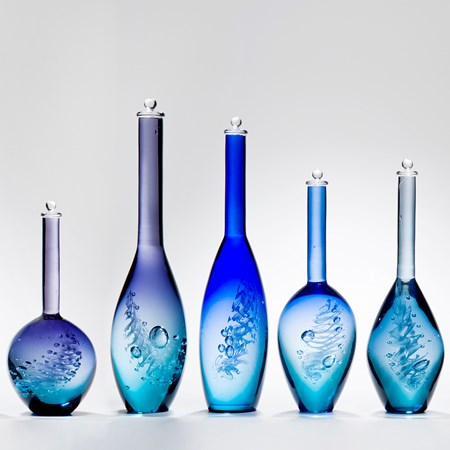 series of five blue art glass bottle sculptures