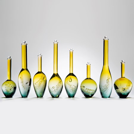 collection of eight handblown yellow and aqua glass vase sculptures with long necks in different sizes
