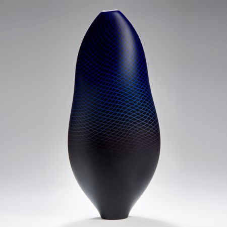 modern art glass sculptured vessel in dark blue with external geometric engraving