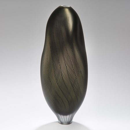 dark and light grey glass art sculpture of abstract vase shape with patterned exterior