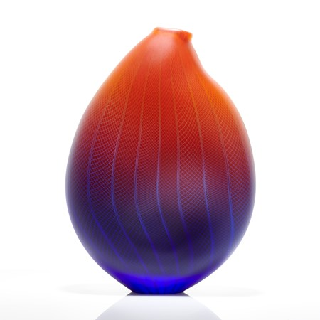 sculpted glass vessel in blue red and orange with small open top and lined and checked external engraved pattern